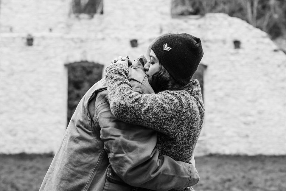 black and white photo of couple hugging at rock wood conservation area - London Cambridge Stratford Woodstock Grand Bend Strathroy Ontario Wedding Engagement Photographer by Dylan Martin Photography with Dylan and Sandra
