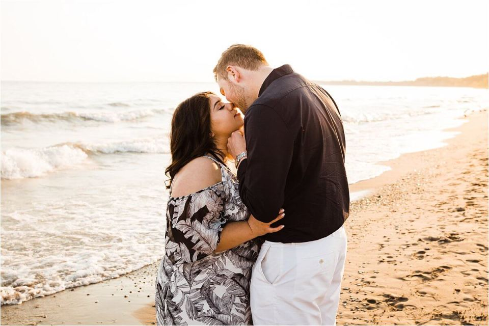 man and woman kissing on beach shore - London Stratford Cambridge Woodstock Wedding Photographer by Dylan and Sandra of Dylan Martin Photography