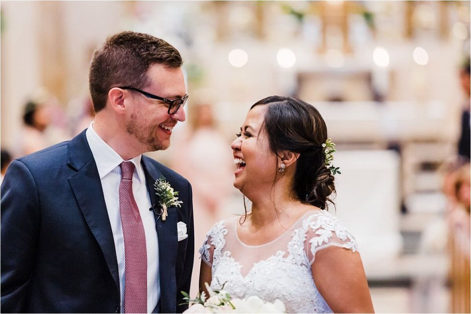 Bride and groom celebrating in church and laughing after getting married - Dylan and Sandra of Dyan Martin Photography for Weddings and Engagement candid photographer in London, Cambridge, Stratford and Woodstock Ontario