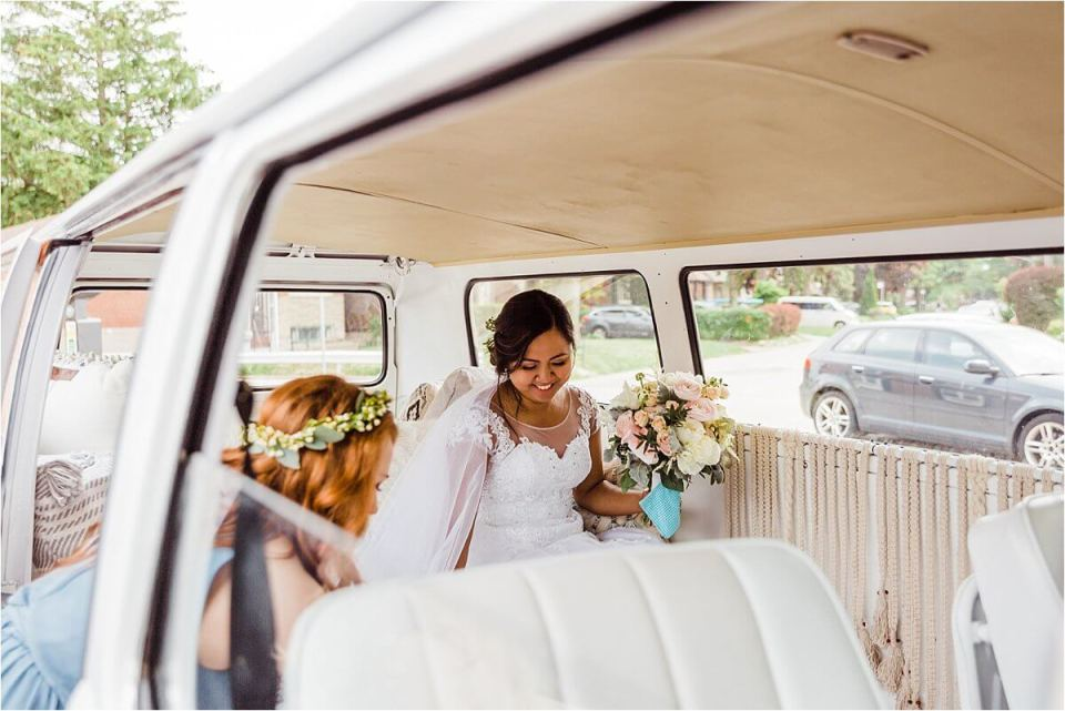 bride climbing into vw comb van on her wedding day - Dylan and Sandra of Dyan Martin Photography for Weddings and Engagement candid photographer in London, Cambridge, Stratford and Woodstock Ontario