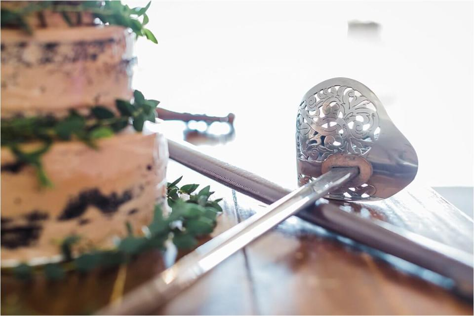 British Ceremonial Sword used to cut the cake during a wedding reception at Inn on the Twenty