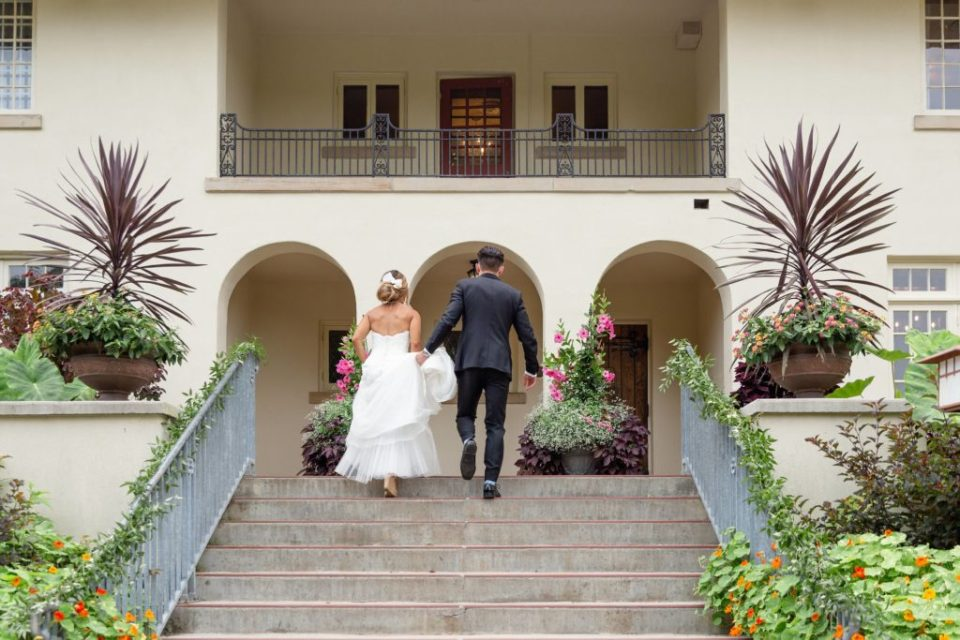 Bride and groom walking up the stairs at Elsie Perrin Williams Estate