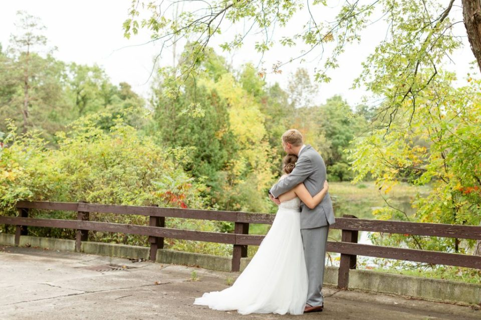 Couple embraces after their first look on the bridge at Ukraina Country Club