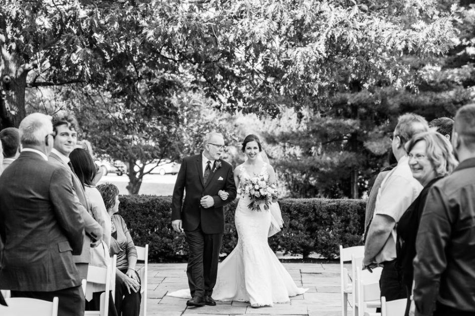 Father of the bride walking his daughter down the aisle to marry the man of her dreams