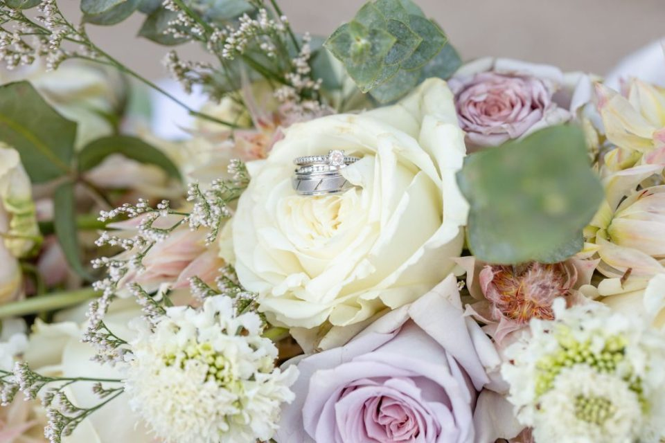 Wedding Day Details - Rings on the bouquet of wedding flowers