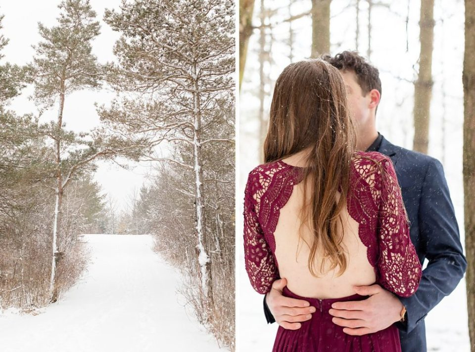 beautiful couple embracing on snowy forest pathway