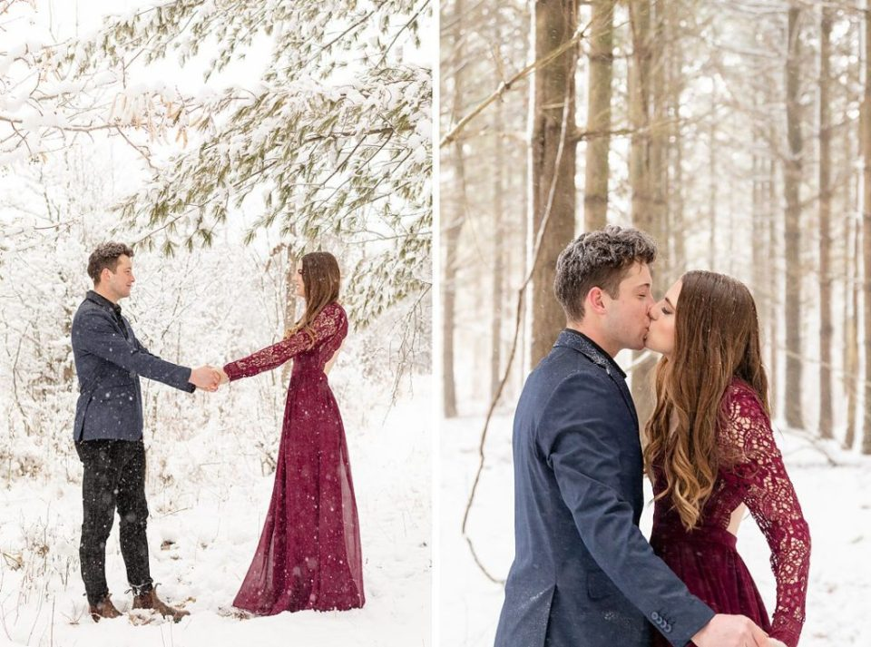 girl in burgundy maxi dress holding hands with her fiancé and kissing