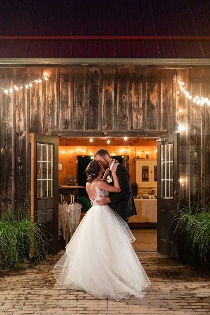 Romantic night kiss under the twinkle lights at Arrowwood Farm