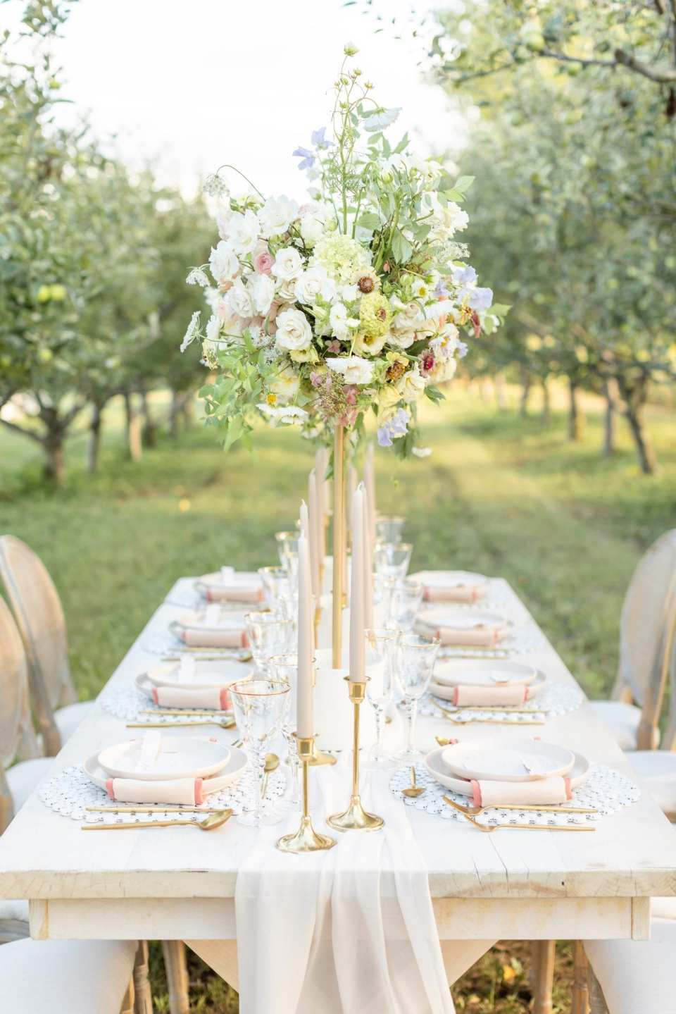 Backyard wedding tips hire a wedding coordinator. Wedding tablescape for an intimate micro wedding between the rows of pear trees at Kurtz Orchard designed by Kassia Tjia Events