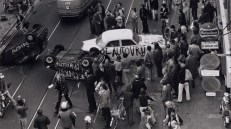 """A 1970s protest in De Pijp neighborhood of Amsterdam with upside down cars painted with """"car free."""" (Source: Bicycle Dutch)"""