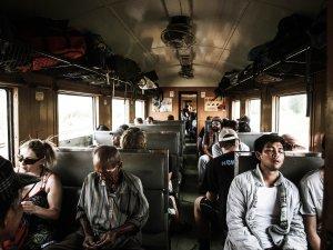 Sleeping while sitting upright on a train Photo by Braden Barwich on Unsplash