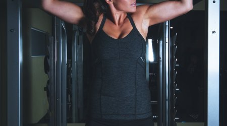 Woman doing a pull-up. Photo by Scott Webb on Unsplash