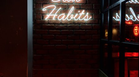 Bad Habits neon light photo by Manan Chhabra on Unsplash