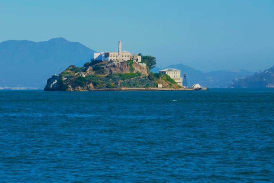 Alcatraz on a rocky island in the middle of the bright blue bay