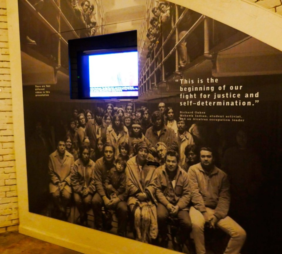 Screen exhibit with a photo of some of the Indian occupiers of Alcatraz