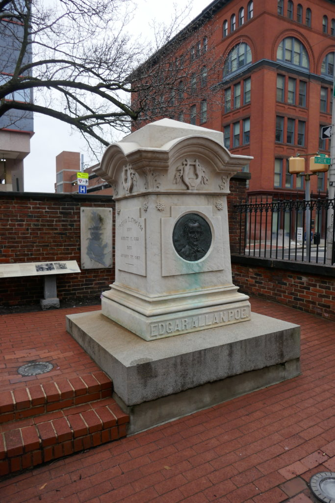 Edgar Allan Poe's marble headstone on a raised brick pavilion