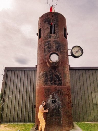 Young woman standing next to a metal tower with a lock at Magic Hat Brewery in South Burlington Vermont