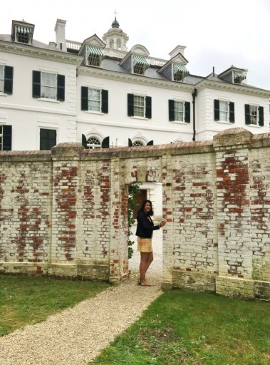 Young woman standing in front of Edith Wharton's large white mansion on a roadtrip of literary Massachusetts spots