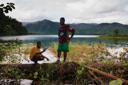 Boys posing in paradise at Lake Hargy. The Nakanai Range in the background.
