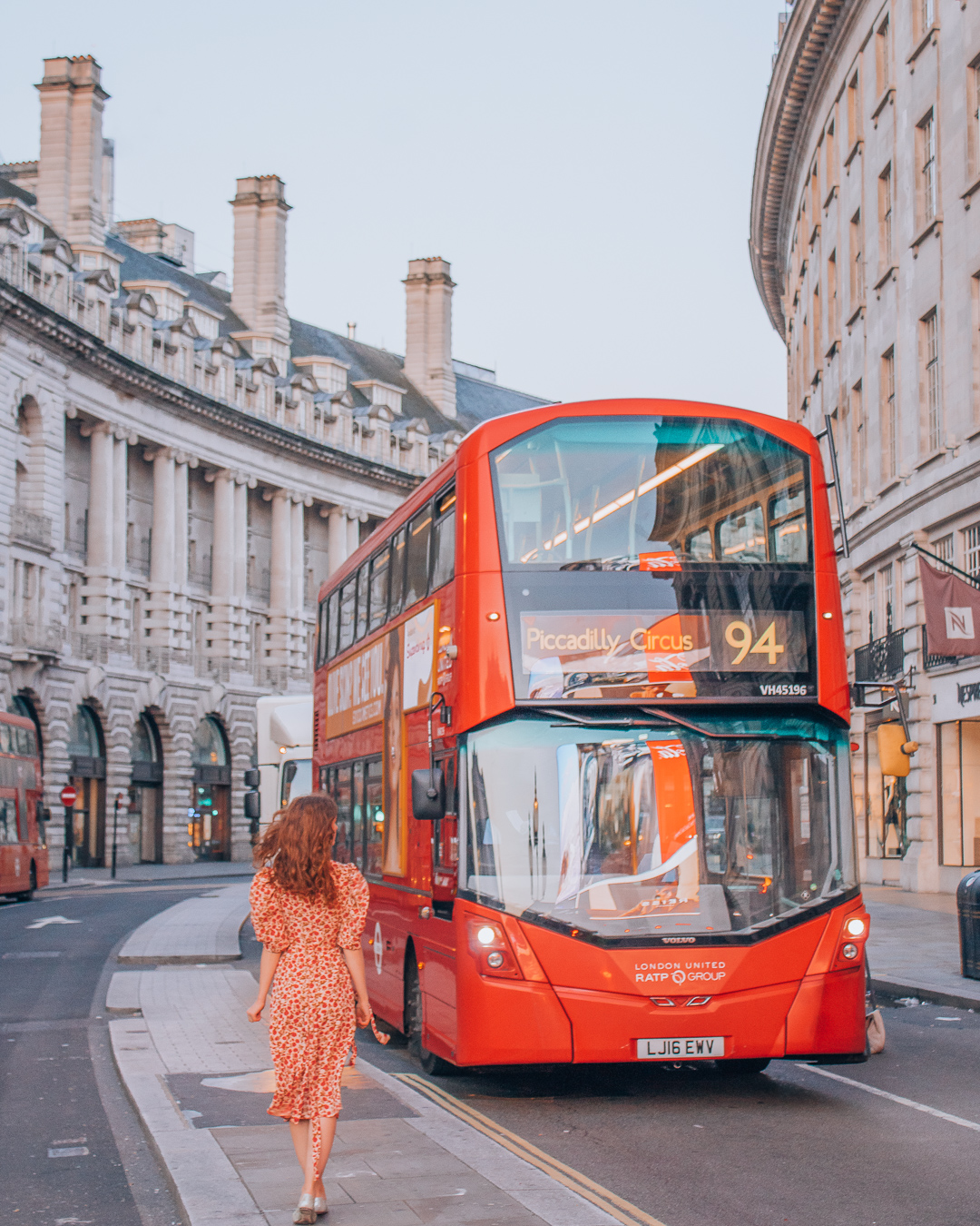 Girl in Regent Street with a red bus