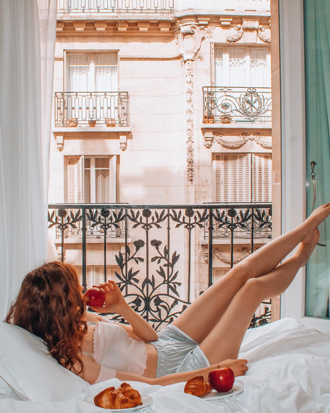 Girl in hotel room in Paris