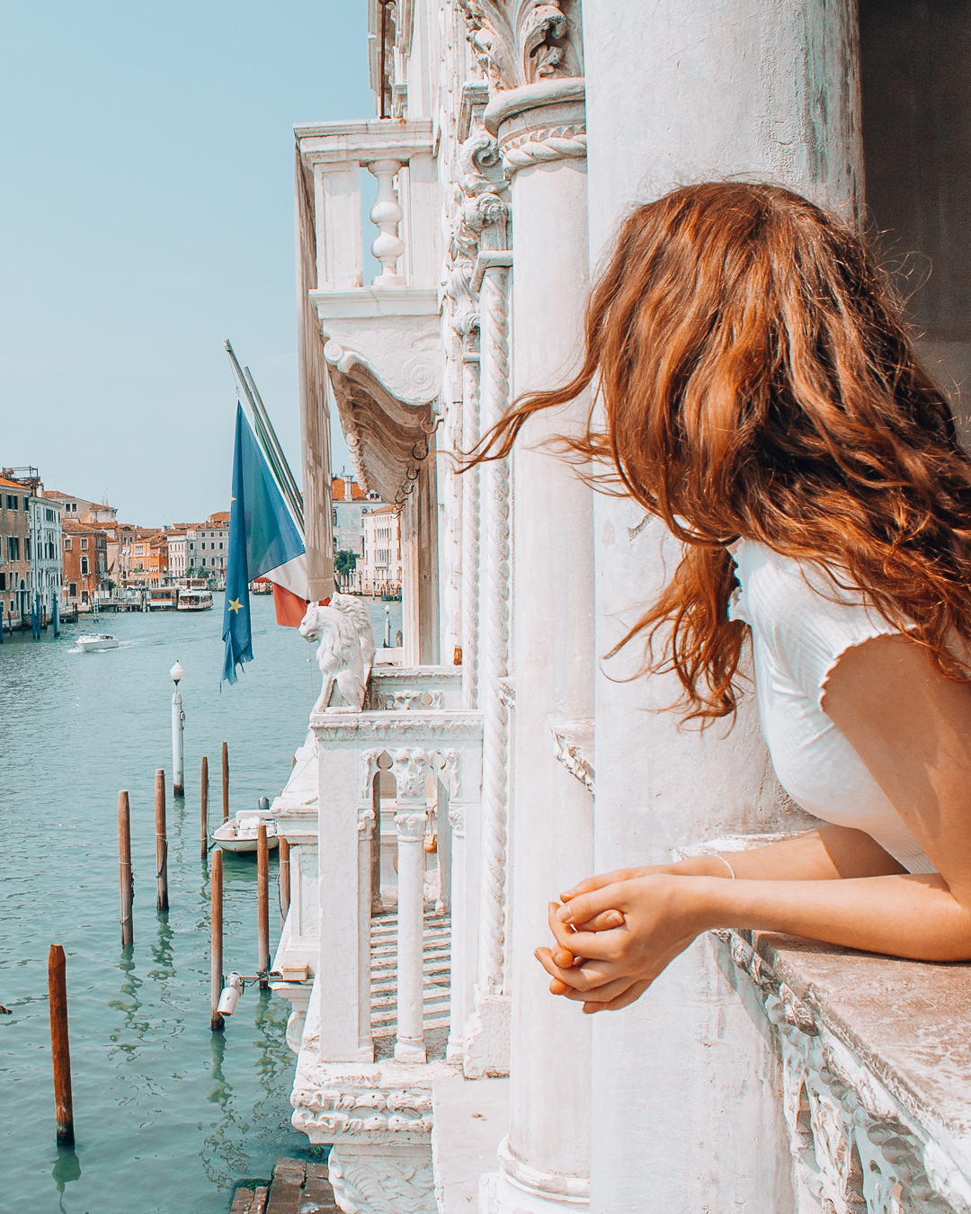 Girl looking at the Grand Canal in Venice