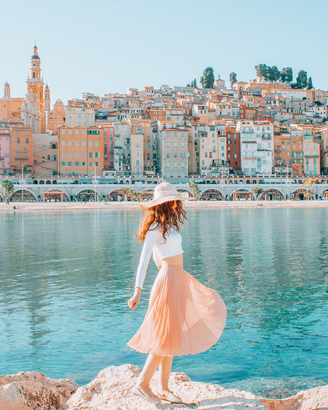 Girl in Menton with a swirling skirt