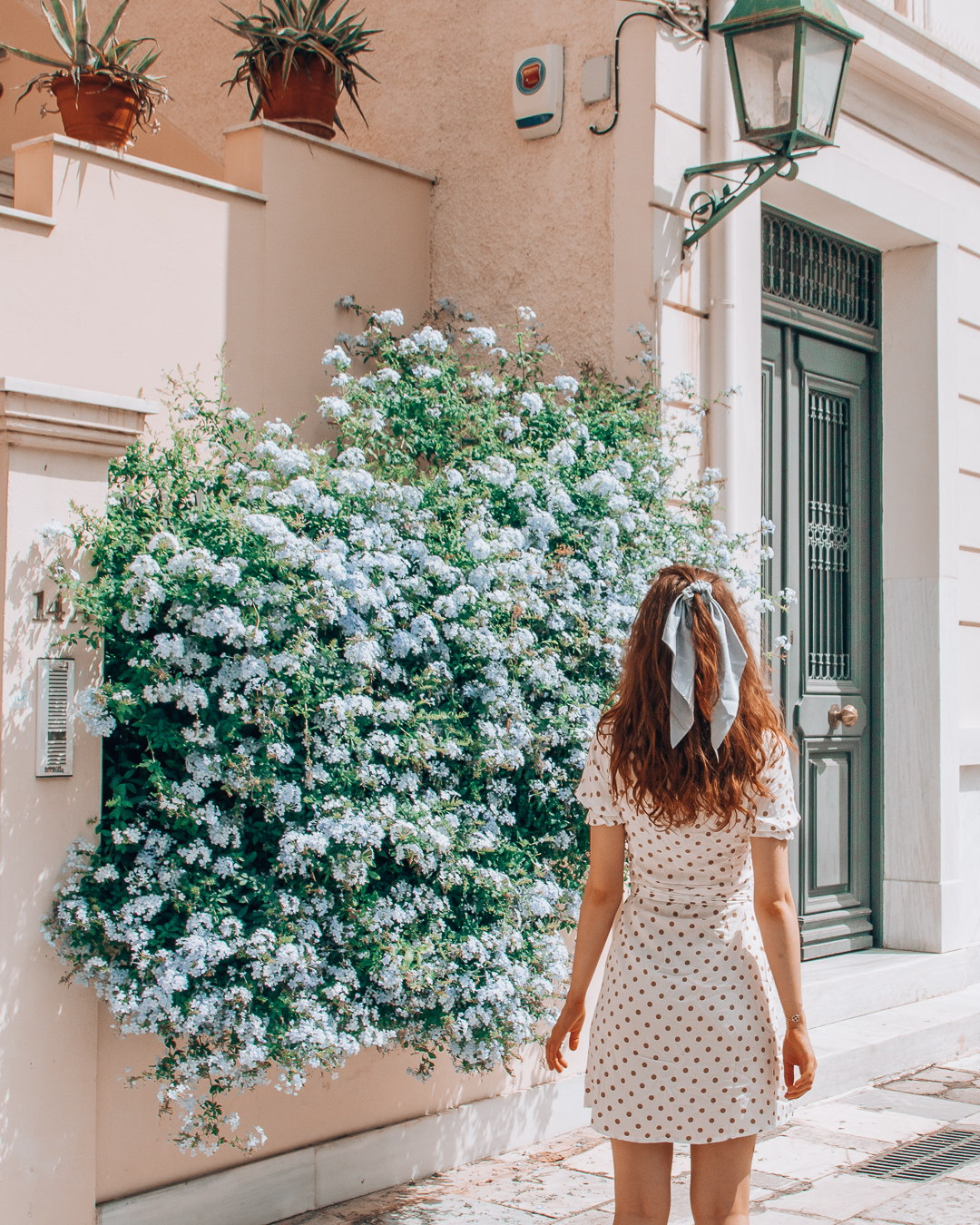 Girl with flowers in Plaka