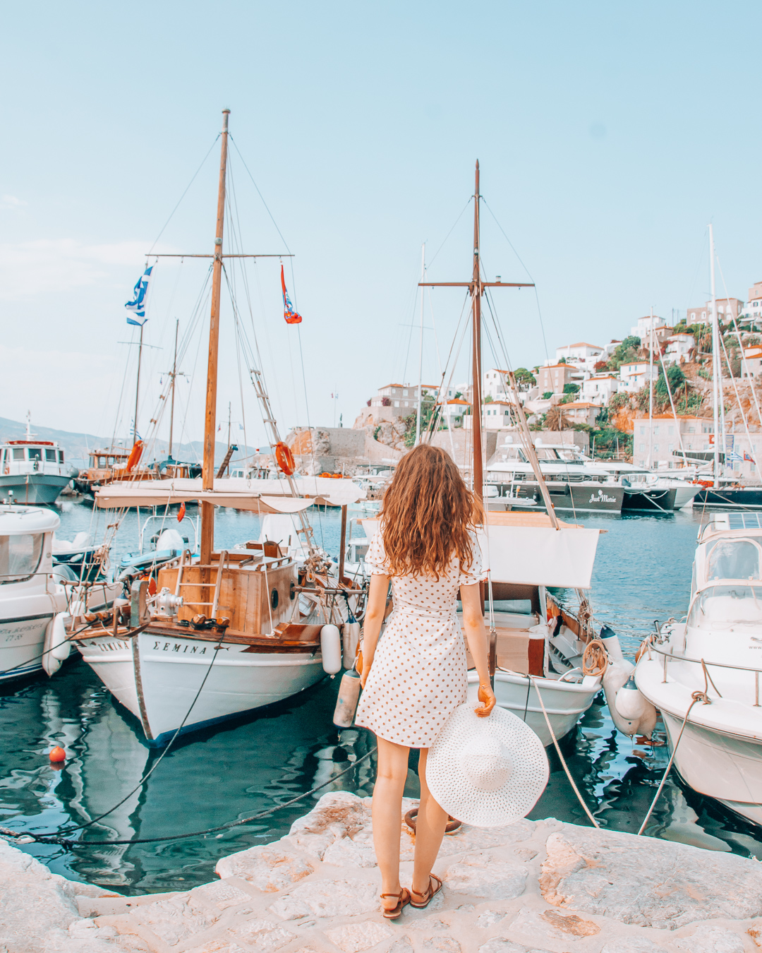 Girl and boats in Hydra