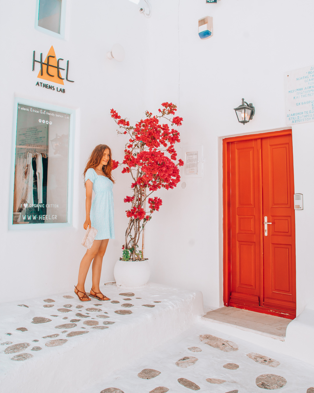 Girl in front of Heel Athens Lab in Mykonos