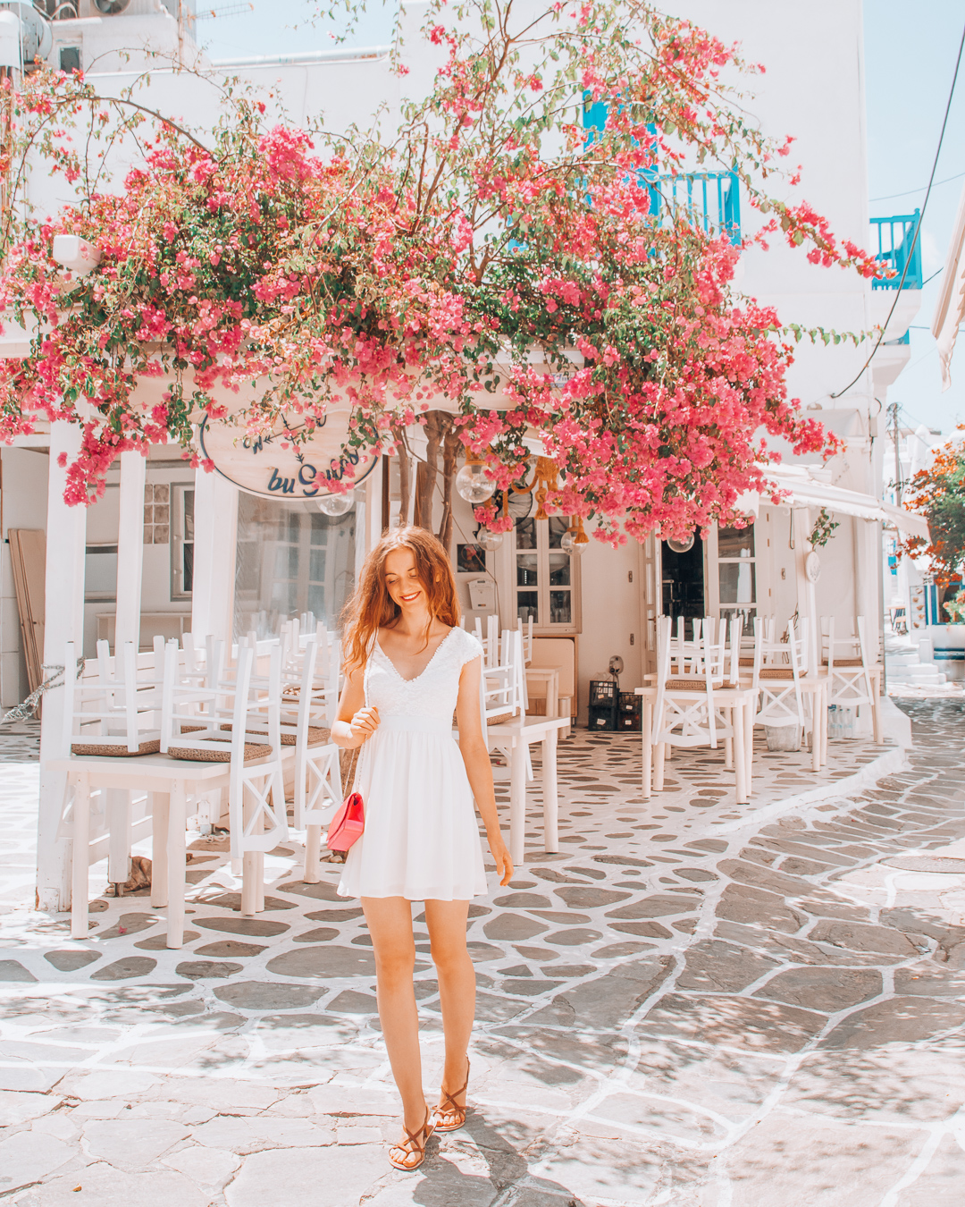 Girl in front of Busulas in Mykonos