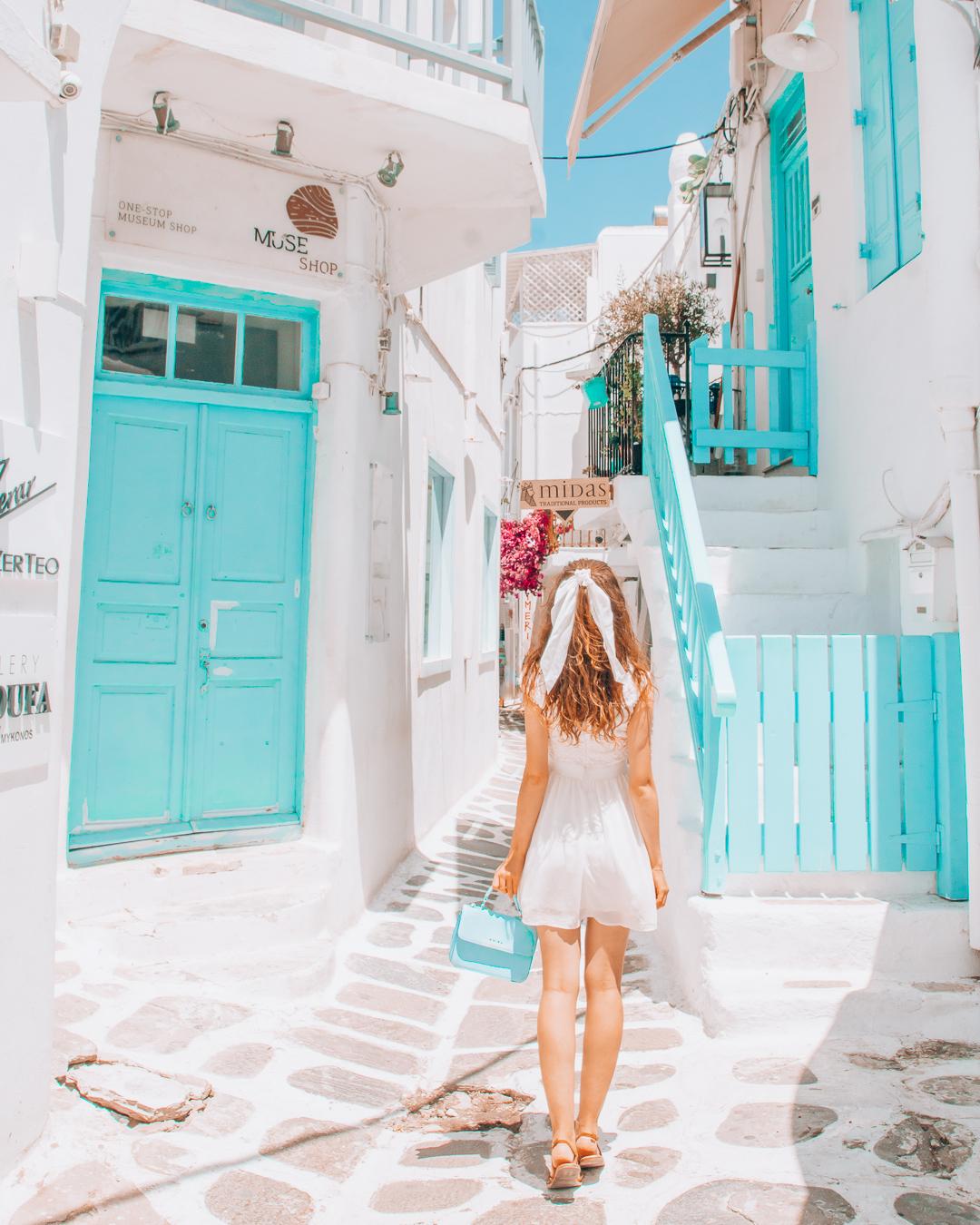 Girl in blue street in Mykonos