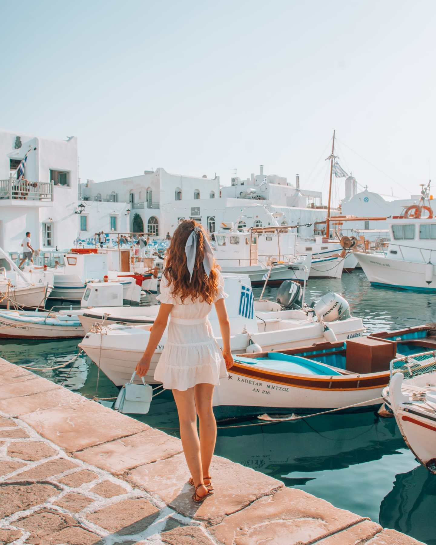 Girl standing at Naoussa Old Port