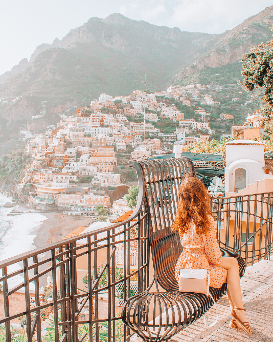 Girl sitting on a bench in Positano