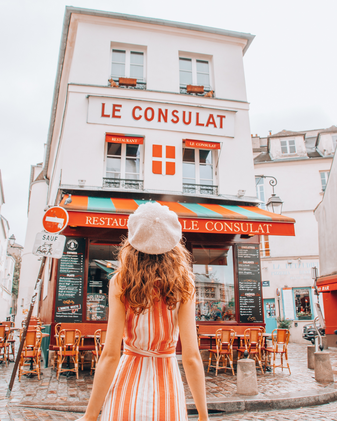 Girl in front of Le Consulat