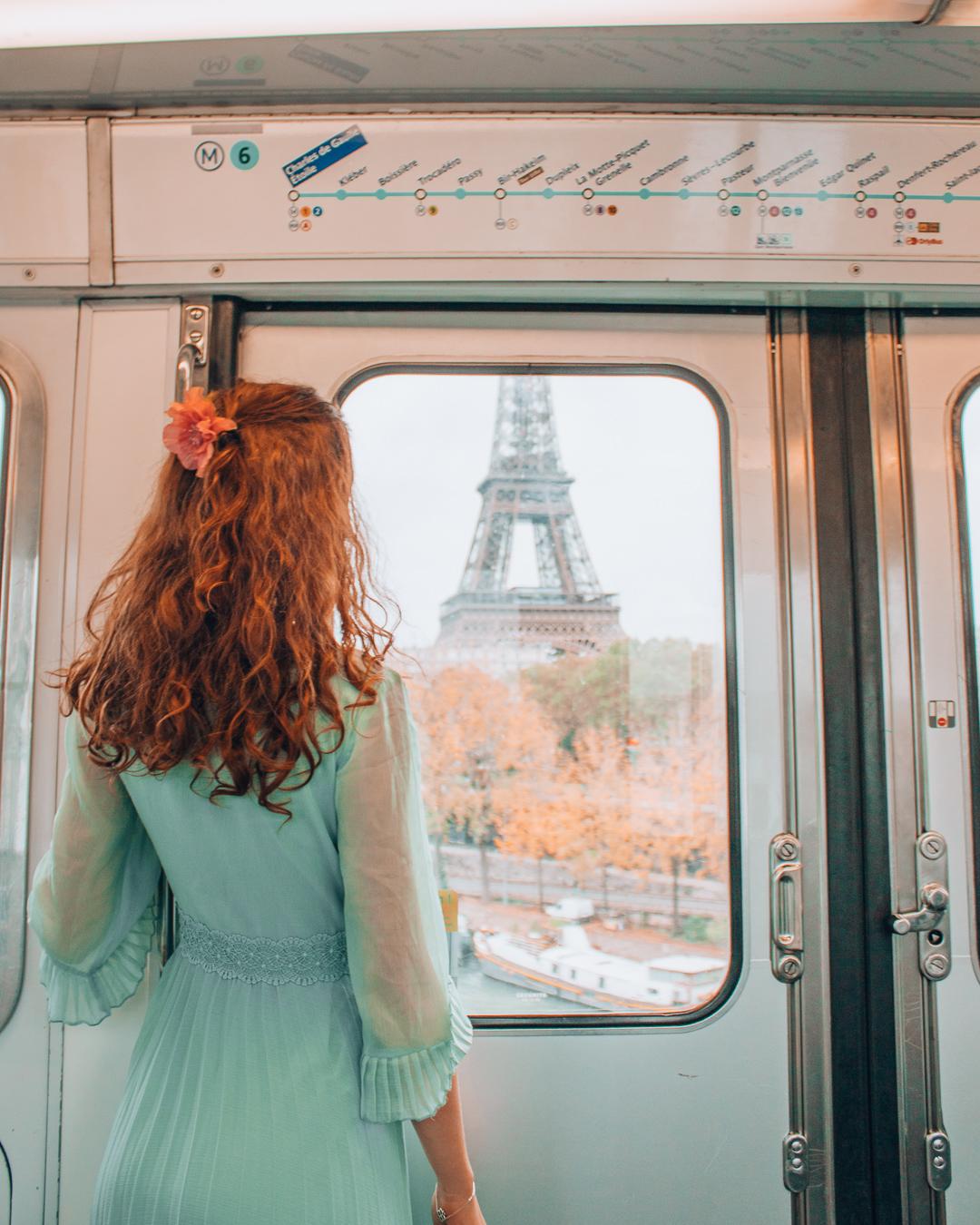 Girl in metro in Paris looking at the Eiffel Tower