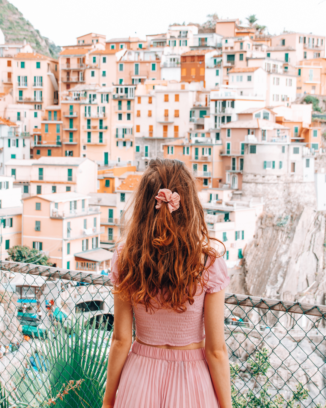 Colourful houses and a girl in Manarola