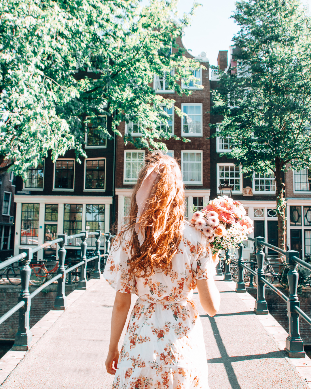 Girl standing on a bridge in Amsterdam