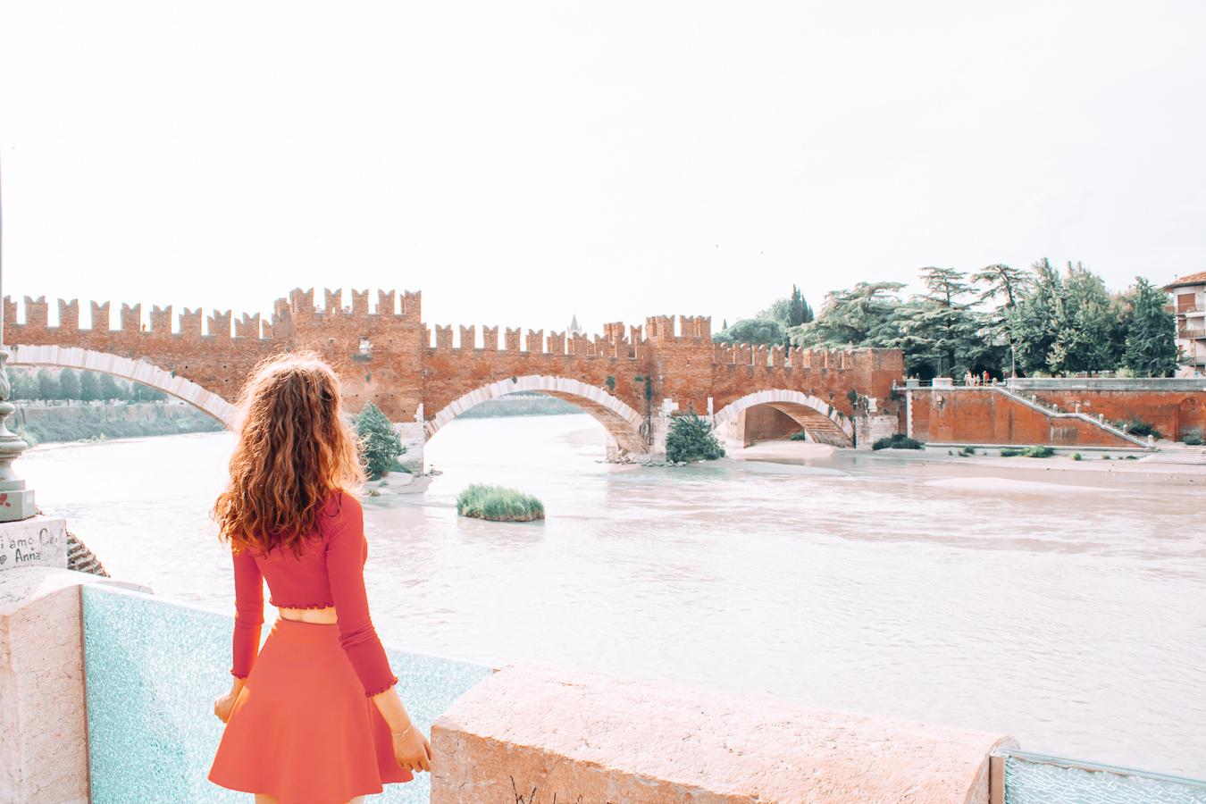 Girl looking at the Castelvecchio Bridge