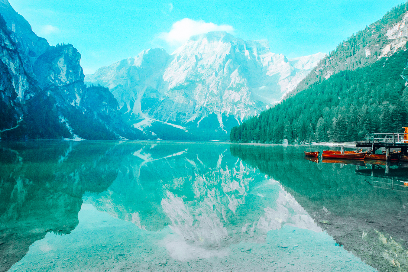 A beautiful lake in the Dolomites with mountains