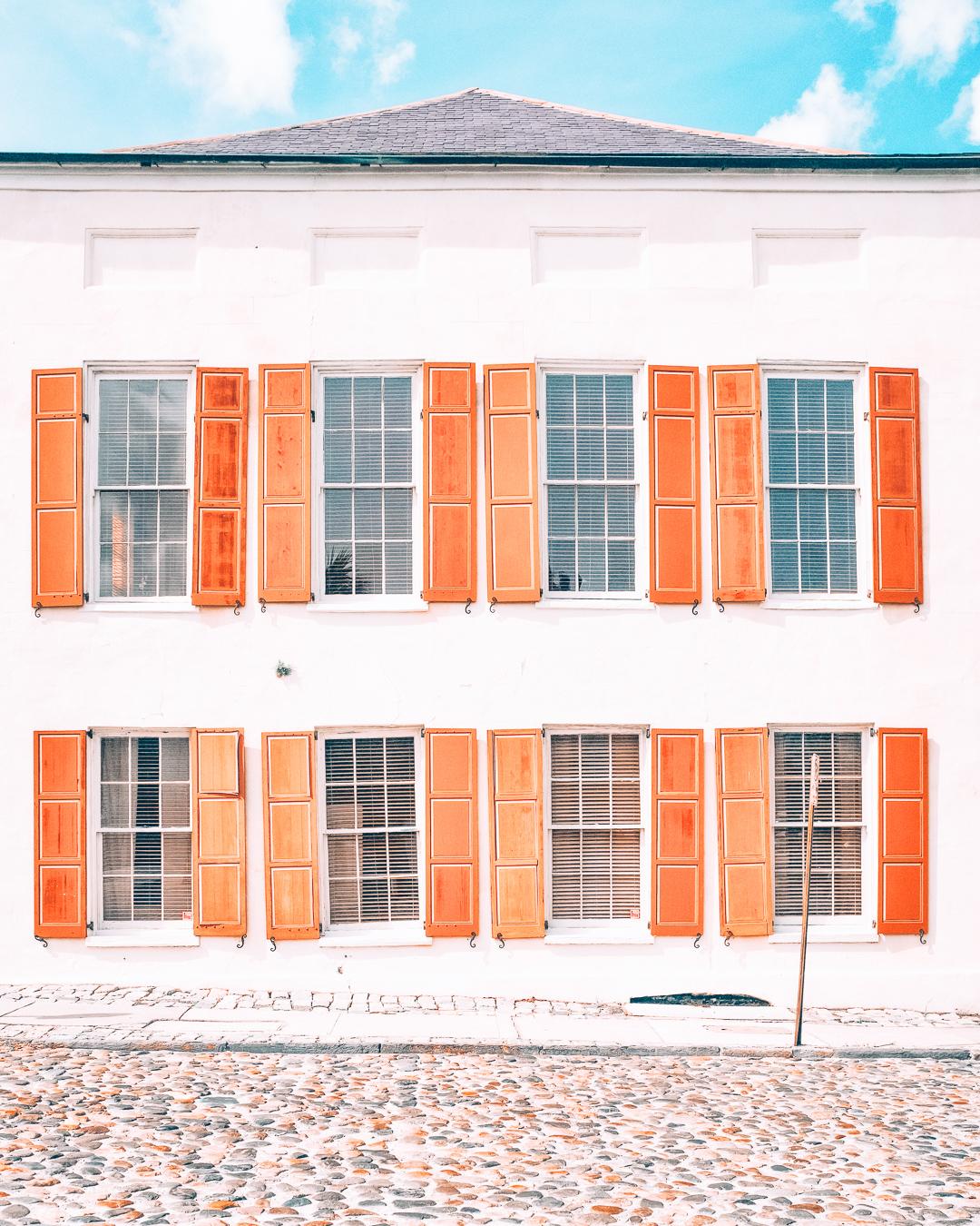 A white building with orange windows