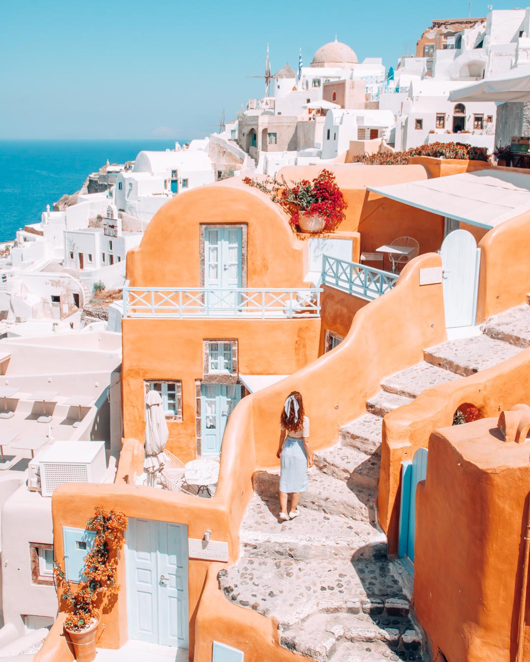 Orange building and white houses in Santorini