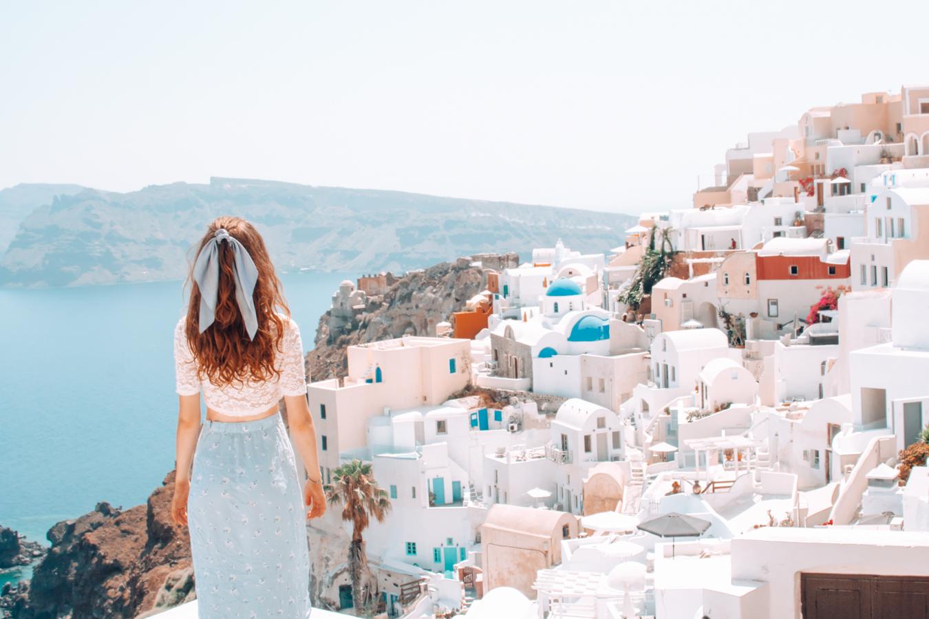 Girl solo in Santorini admiring the view