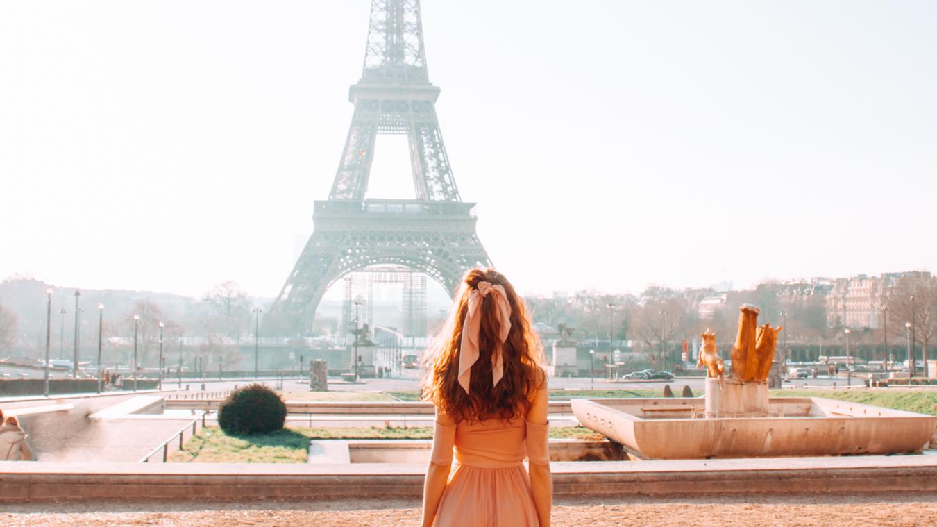 Girl in Paris at Trocadéro looking at the Eiffel Tower