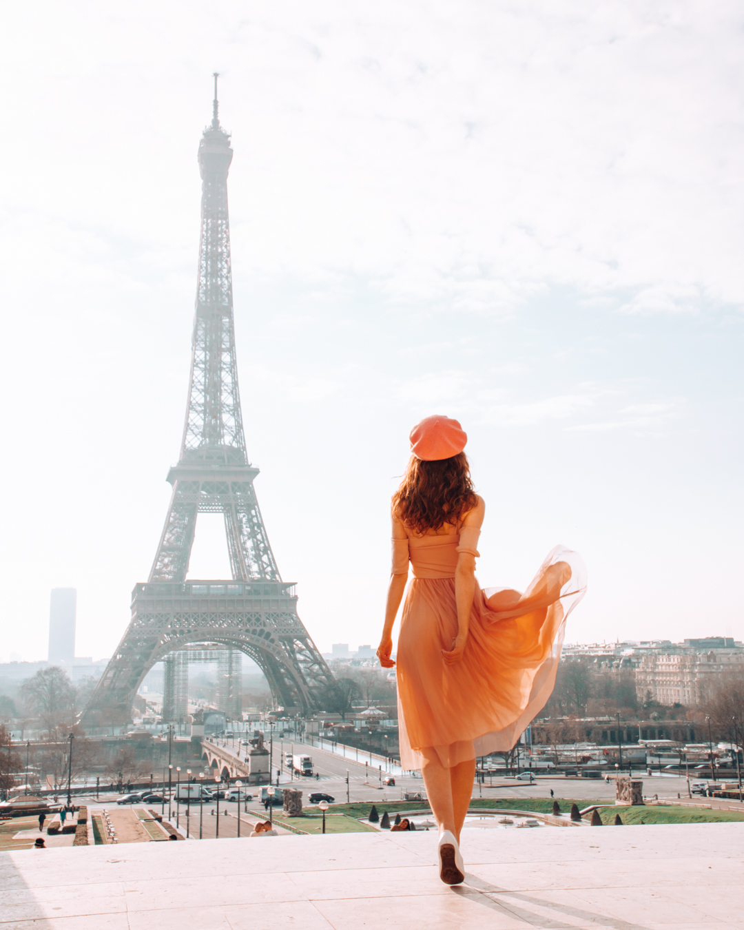Girl at the Eiffel Tower in Paris