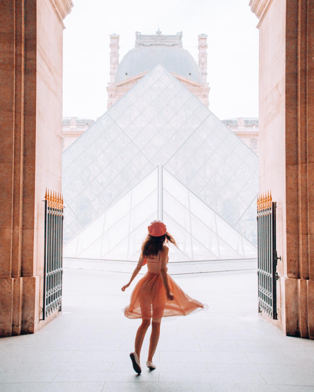 Girl running towards the Louvre