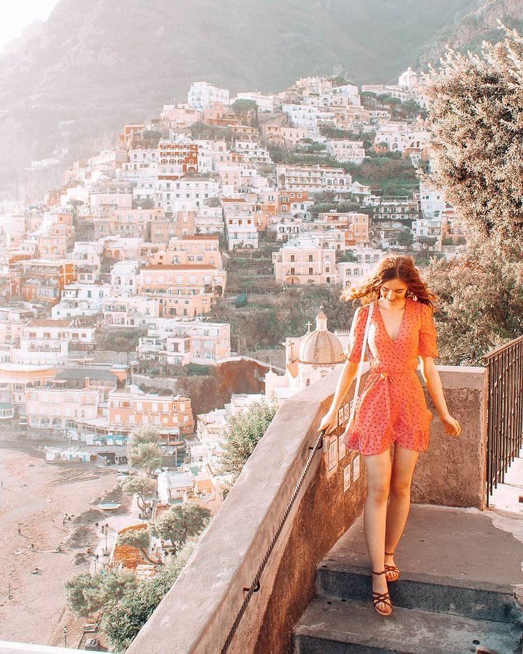 Girl in dress on beautiful stairs in Positano