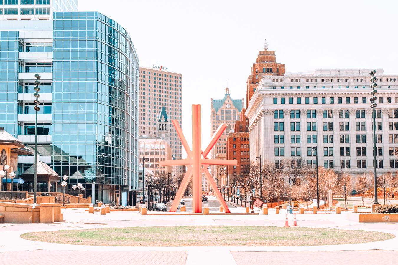 Orange sculpture and buildings