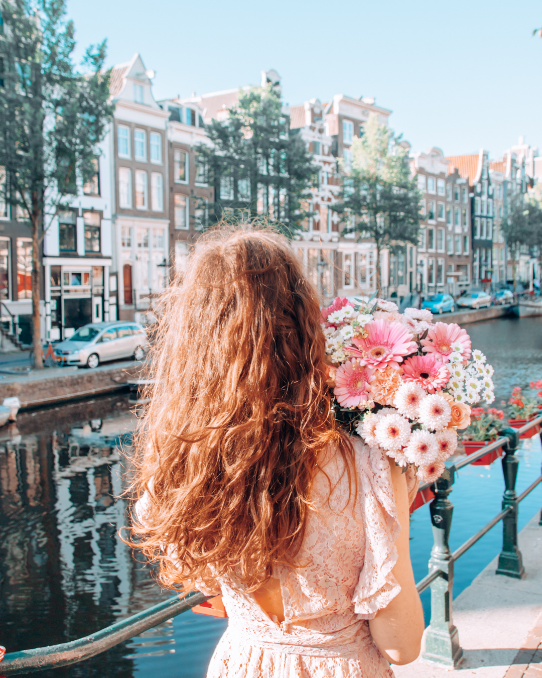 View of Amsterdam and a girl with flowers
