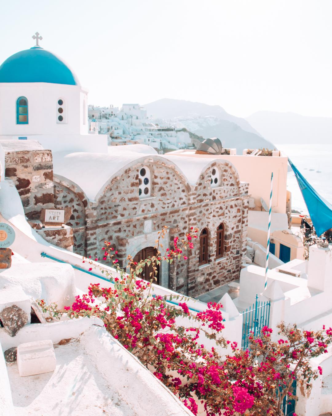 Flowers and buildings in Santorini